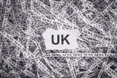 Closeup torn pieces and tapes of paper with the word UK. Stock Photo