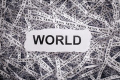 Closeup torn pieces and tapes of paper with the word WORLD. Stock Photography