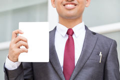 Closeup of torso of Asian businessman showing blank paper. And smiled stock photos