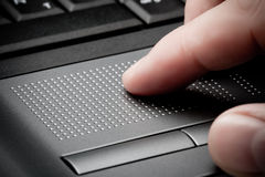 Closeup touchpad with finger Royalty Free Stock Image