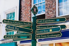 Closeup on tourist Sign posts in city of York, UK Royalty Free Stock Images