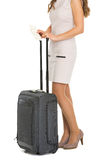 Closeup on tourist woman with bag and air tickets Royalty Free Stock Images