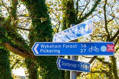 Closeup on touristic Sign posts in village of Ravenscar, UK Royalty Free Stock Photo