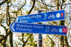 Closeup on touristic Sign posts in village of Ravenscar, UK Stock Photos