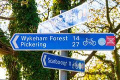 Closeup on touristic Sign posts in village of Ravenscar, UK Stock Photo