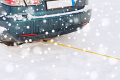 Closeup of towed car with towing rope Stock Images