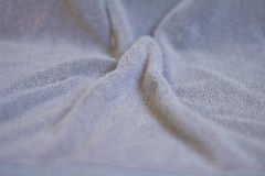 Closeup of towel. Closeup view of towel. Fluffy gray background Stock Images