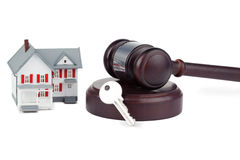 Closeup of a toy house model and a brown gavel Royalty Free Stock Photos