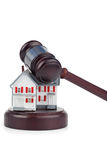Closeup of a toy house model and a brown gavel Stock Photography