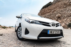 CLoseup of Toyota Auris staying among mountains near Sitia town on Crete island, Greece Royalty Free Stock Photo