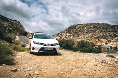 Closeup of Toyota Auris staying among mountains near Sitia town on Crete island, Greece Stock Photo
