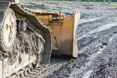Closeup of tracked loader excavator at construction area Stock Image