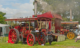 Closeup of Traction Engine at Pickering. Closeup of Traction Engine at the annual rally held in Pickering from 2nd to 5th August 2012 with fairground big wheel Royalty Free Stock Images