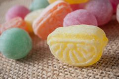 Traditional candies on hessian background. Closeup of traditional candies on hessian background royalty free stock images