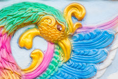 Closeup traditional colorful artwork of the mythical bird phoeni. X on a wall in Chinese temple Royalty Free Stock Images