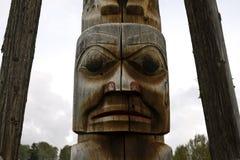 Closeup of traditional Gitxsan totem poles Royalty Free Stock Image