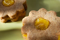 Closeup of traditional linzer cookies with lemon  cream Royalty Free Stock Photography