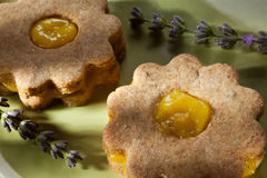 Closeup of traditional linzer cookies with lemon cream and lavender Stock Photos
