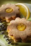Closeup of traditional linzer cookies with lemon and lavender cream Royalty Free Stock Photo