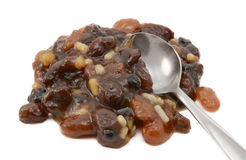 Closeup of traditional mincemeat mixture. Of dried fruit, candied peel and suet, with a metal teaspoon, isolated on a white background Stock Photos