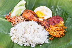Closeup on traditional nasi lemak cuisine on banana leaf with fried chicken Royalty Free Stock Photos