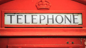 Closeup traditional red telephone box in UK Stock Photo