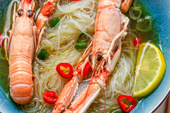 Closeup of traditional Thai soup with scampi stock photos