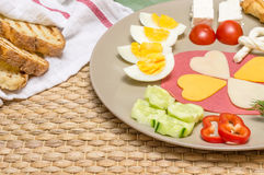 Closeup of traditional Turkish breakfast served on plate with cheese, salami, boiled egg,  tomato, cucumber and toasted bread Royalty Free Stock Photo