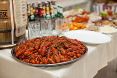 Closeup of traditional ukrainian wedding reception feast table w. Ith red lobsters on a platter Royalty Free Stock Image