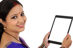 Closeup of tradtional woman holding tablet computer Royalty Free Stock Photo