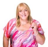 Closeup of Transgender Woman. Closeup of smiling transgender woman in pink blouse on white background Stock Image