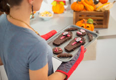 Closeup on tray with Halloween biscuits in hands of housewife Royalty Free Stock Image