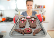 Closeup on tray with Halloween biscuits in hands of housewife Stock Photos