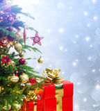 Closeup of tree christmas decorated with presents Stock Photo