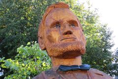 Closeup of tree stump carved into likeness of Abraham Lincoln. royalty free stock photo