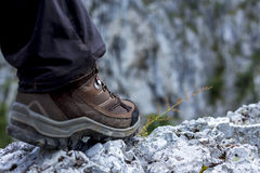 Closeup of trekking boot in the mountain Royalty Free Stock Photos