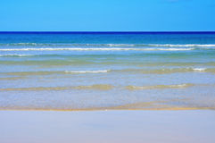 Closeup of a tropical blue beach Royalty Free Stock Photography