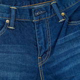 Closeup trousers blue jean and stitch, Blue denim background Royalty Free Stock Images