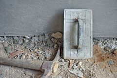 Closeup of trowel and pick at construction site royalty free stock image