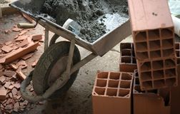 Closeup of trowel on the wheelbarrow with mortar stock photos