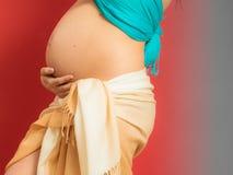 Closeup tummy of pregnant woman Royalty Free Stock Photos