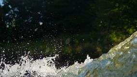 Closeup of turbulent water torrent, splashes in air, spring. Stock footage stock footage