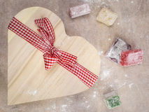 Closeup of turkish delight with a  heart shaped gift box tied wi Stock Photos