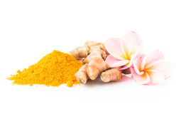 Closeup turmeric powder and turmeric roots on white background f stock images