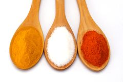 Closeup of turmeric, salt and red chilli powder Stock Images
