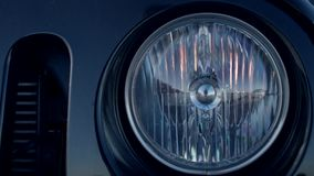 Closeup of the turning off headlight of a car. Closeup of the turning off headlights of a car. Headlamp of the modern blue car stock video footage