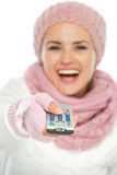 Closeup on TV remote control in hand of woman Royalty Free Stock Photo