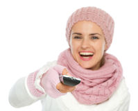 Closeup on TV remote control in hand of woman Royalty Free Stock Image