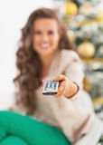 Closeup on tv remote control in hand of young woman Stock Photos