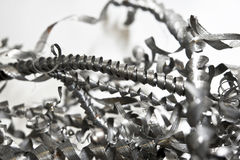 Closeup twisted spiral steel shavings. Drilling industry Royalty Free Stock Photos